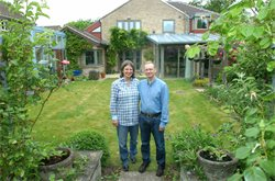 Anne Cooper and Simon Ruffle in the garden of the 'Eco-Home'